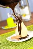Peer in chocolade Stock Foto's