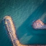 Peer in port Saplaya, Valencia. Spain, water and rocks Stock Images