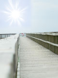 Peer to the beach. End of the bridge, Peer on the beach Royalty Free Stock Image