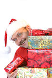 Peering around the presents Stock Photos
