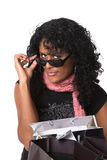 Peering over her sunglasses Stock Images