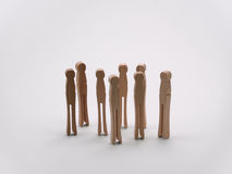 Peers. A bunch of clothespins standing in a group Stock Image