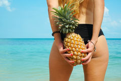 Pefect Vacation. Summer travel. Female Back with Pineapple in sunny day by the Sea Stock Images