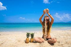 Pefect Vacation. Summer travel. Young beautiful funny model Playing with Sand on the beach in sunny day Royalty Free Stock Images