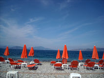 Pefki, Evia Island, Greece. Beach umbrella, chairs and peace Stock Images