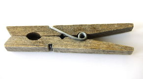 Peg. An old, simple wooden clothespeg with a metal spring Royalty Free Stock Image
