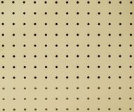 Peg board or ceiling board texture stock photo