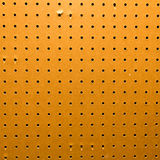 Peg board texture closeup Royalty Free Stock Photo