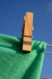 Peg on a Clothes Line. A clothes line or washing line is any type of rope, cord, or twine that has been stretched between two points (e.g. two sticks), outside Stock Photo