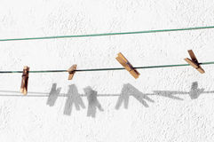 Peg for clothes and shadows. Peg for clothes hanging on rope and shadows stock images