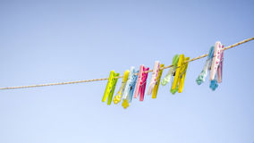 Peg. Colorful clothes pegs on a rope Stock Photography