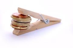 Peg com moedas Fotografia de Stock