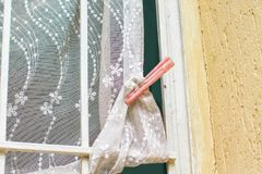 Peg on the curtain. Peg curtain old window vintage red royalty free stock images
