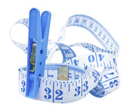 Peg your waist to 32 inches. A tape measure with a peg marking 32 inches - the healthy waist measurement for a woman Stock Photo