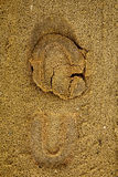 Pegada na areia Imagens de Stock