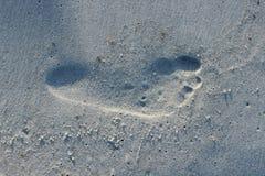Pegada na areia da praia Imagens de Stock
