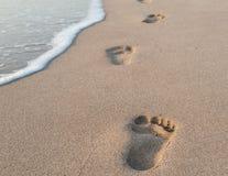 Pegadas da areia fotografia de stock