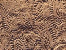 Pegadas da sapata na areia Foto de Stock
