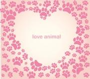 Pegadas do animal do coração Foto de Stock