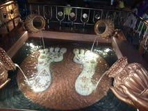 Pegadas do krishna do senhor Fotos de Stock