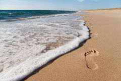 Pegadas na areia Fotografia de Stock