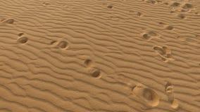 Pegadas na duna de areia, grões de areia, Corralejo, parque natural Fuerteventura Fotografia de Stock