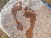 Pegadas na pedra Foto de Stock Royalty Free