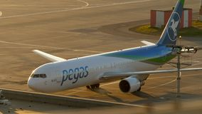Pegas Fly passenger airliner driving off in Sheremetyevo Airport, Moscow. MOSCOW, RUSSIA - AUGUST 07, 2017: Passenger airplane of Pegas Fly airlines leaving the stock video footage