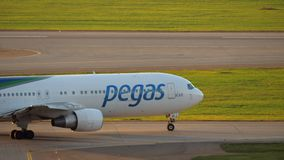 Pegas Fly plane driving to runway in Sheremetyevo Airport, Moscow. Moscow, Russia - August 07, 2017: Pegas Fly passenger airliner turning and driving to take-off stock video footage