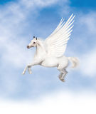 Pegasus. Flying with a blue cloudy sky Stock Photo
