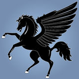 Pegasus. Silhouette of  black Pegasus on blue backgrounds Royalty Free Stock Image