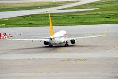 Pegasus Airplane wheeling to the runway. A Pegasus airplane Boing 737 is rolling to the runway at Stuttgart airport Stock Image