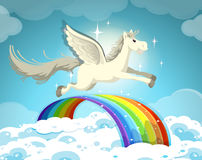 Pegasus flying over the rainbow Stock Images