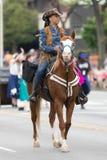 The Pegasus Parade 2018. Louisville, Kentucky, USA - May 03, 2018: The Pegasus Parade, African American woman riding a horse down w broadway during the parade stock photos