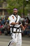 The Pegasus Parade 2018. Louisville, Kentucky, USA - May 03, 2018: The Pegasus Parade, Man in martial arts uniform walking down W broadway stock photography