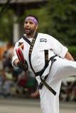 The Pegasus Parade 2018. Louisville, Kentucky, USA - May 03, 2018: The Pegasus Parade, Man in martial arts uniform walking down W broadway stock photos