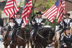 The Pegasus Parade 2018. Louisville, Kentucky, USA - May 03, 2018: The Pegasus Parade, Members of the Company B Drill Team from Hardin County, Kentucky, Riding royalty free stock image