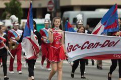 The Pegasus Parade 2018. Louisville, Kentucky, USA - May 03, 2018: The Pegasus Parade, Members of the Jac-Cen-Del cheerleaders and Marching band from Osgood stock photography