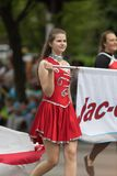 The Pegasus Parade 2018. Louisville, Kentucky, USA - May 03, 2018: The Pegasus Parade, Members of the Jac-Cen-Del cheerleaders and Marching band from Osgood royalty free stock image