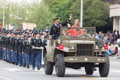 The Pegasus Parade 2018. Louisville, Kentucky, USA - May 03, 2018: The Pegasus Parade, Military Vehicle ahead of marching united states army troops, going down w royalty free stock image
