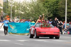 The Pegasus Parade 2018. Louisville, Kentucky, USA - May 03, 2018: The Pegasus Parade, Miss America riding on a Corvette, down W Broadway st royalty free stock photo