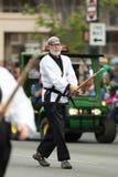 The Pegasus Parade 2018. Louisville, Kentucky, USA - May 03, 2018: The Pegasus Parade, People in martial arts uniforms practicing kendo during the parade royalty free stock image