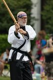 The Pegasus Parade 2018. Louisville, Kentucky, USA - May 03, 2018: The Pegasus Parade, People in martial arts uniforms practicing kendo during the parade stock images