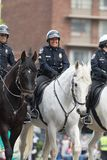 The Pegasus Parade 2018. Louisville, Kentucky, USA - May 03, 2018: The Pegasus Parade, Police Officers with horses, going down W Broadway stock image