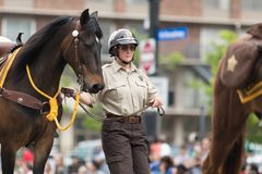 The Pegasus Parade 2018. Louisville, Kentucky, USA - May 03, 2018: The Pegasus Parade, Police Officers with horses, going down W Broadway stock photos
