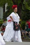 The Pegasus Parade 2018. Louisville, Kentucky, USA - May 03, 2018: The Pegasus Parade, Women wearing traditional mexican clothing dancing during the parade stock photo