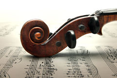 Pegbox and scroll of violin on sheed music Royalty Free Stock Images