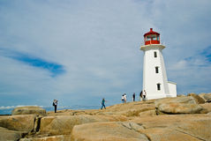 Peggy's Cove lighthouse. Tourists visiting Peggy's Cove lighthouse, Halifax, Nova Scotia royalty free stock photo