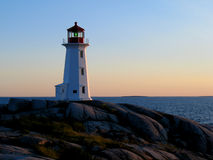 Peggy's Cove Lighthouse. The lighthouse at Peggy's Cove in Nova Scotia at dusk. One of the most popular tourist destinations in North America Stock Photo
