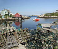 Peggys Cove. Canoe moored in Peggys Cove, Nova Scotia with lobster traps in foreground Royalty Free Stock Photos